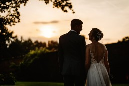thorpe garden sunset with bride and groom
