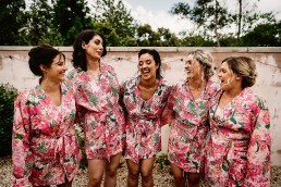 bridesmaids having fun at barns and yard wedding