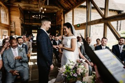 exchanging rings during the barns and yard wedding ceremony